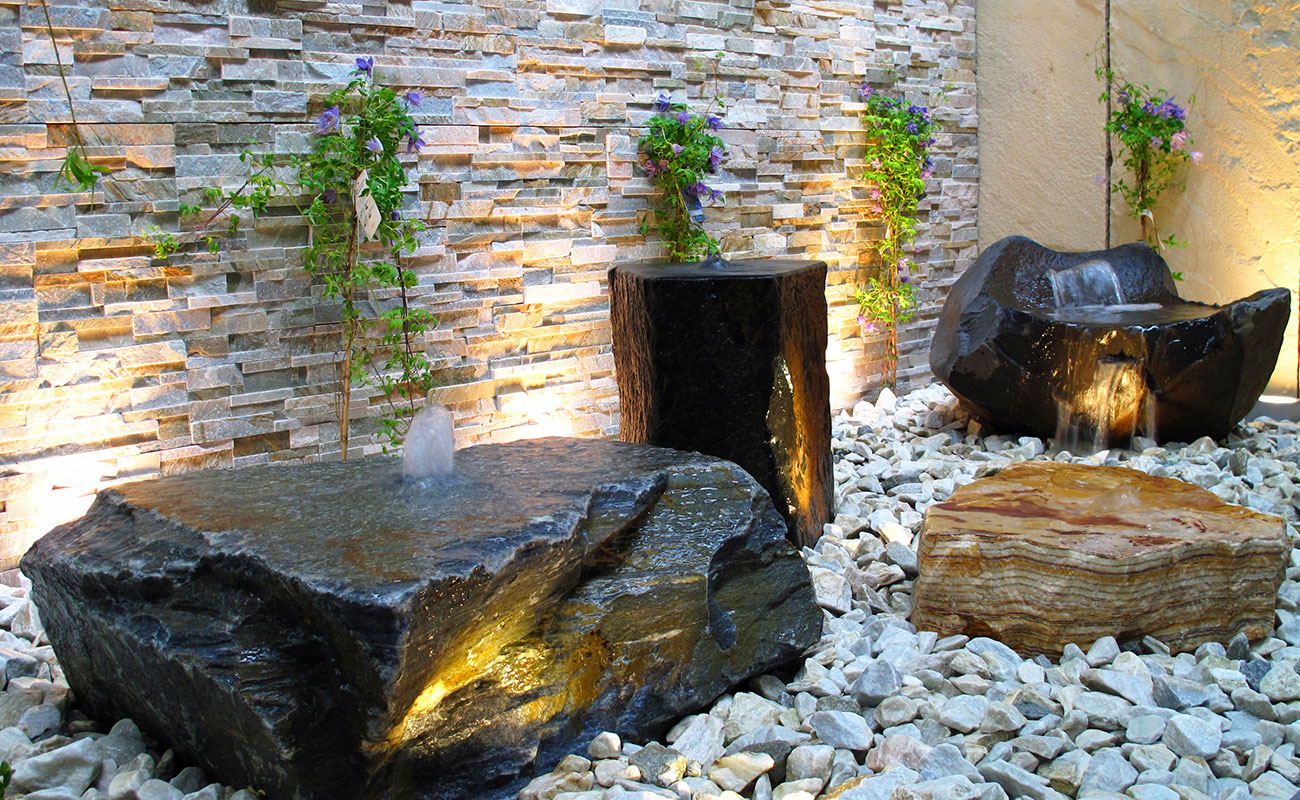 Rock garden with uplighting and waterfall