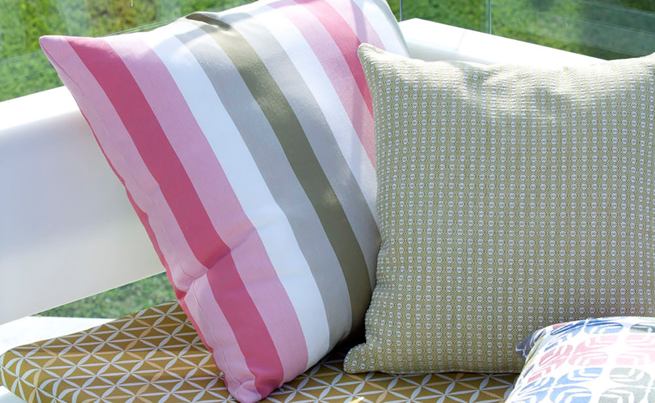 Three bright and cheerful coloured cushions to accessorise outdoor couch
