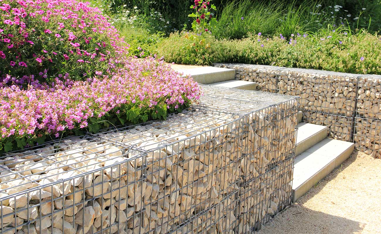 Gabion filled with white rocks used as a retaining wall.