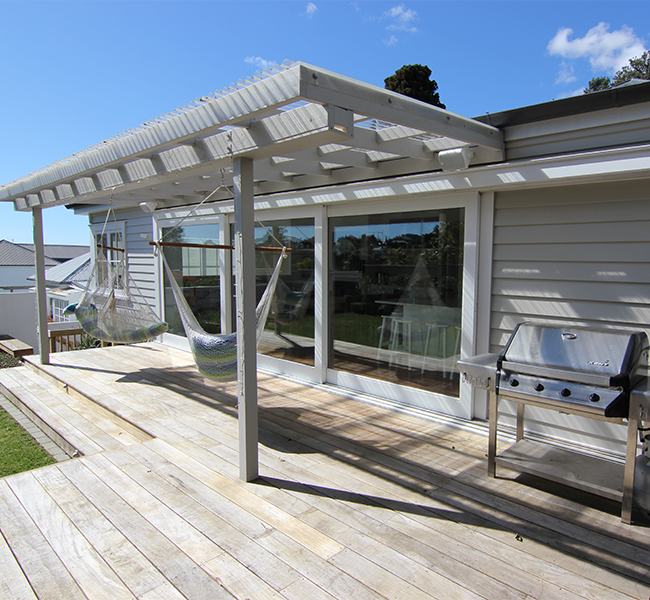 Basic wooden deck with two hammocks - Cost Of A Basic Deck And Pergola Zones