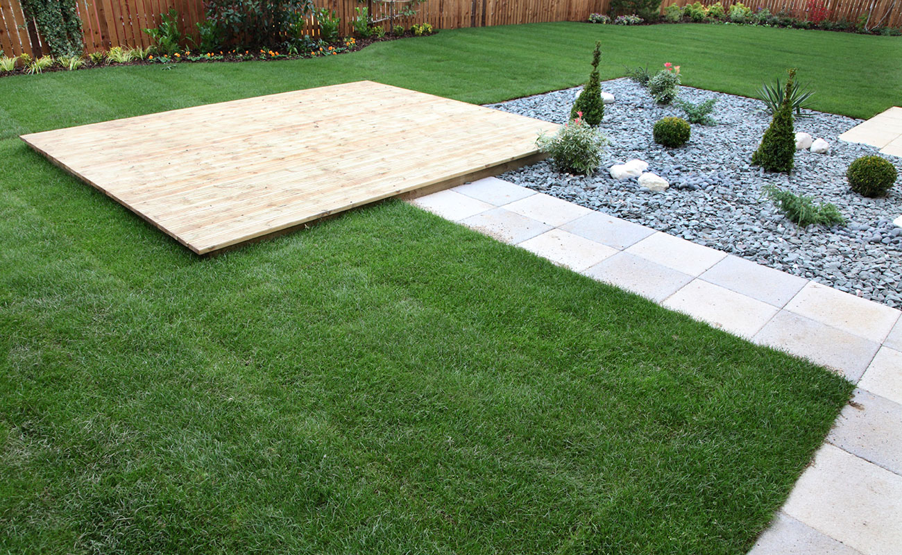 Stone garden mixed with some grassy areas and platforms and pavers