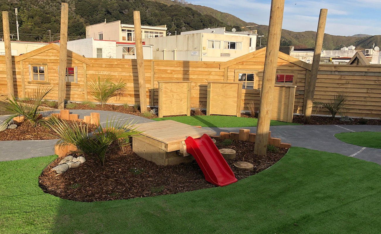 renovated childcare with a kool fences red slide