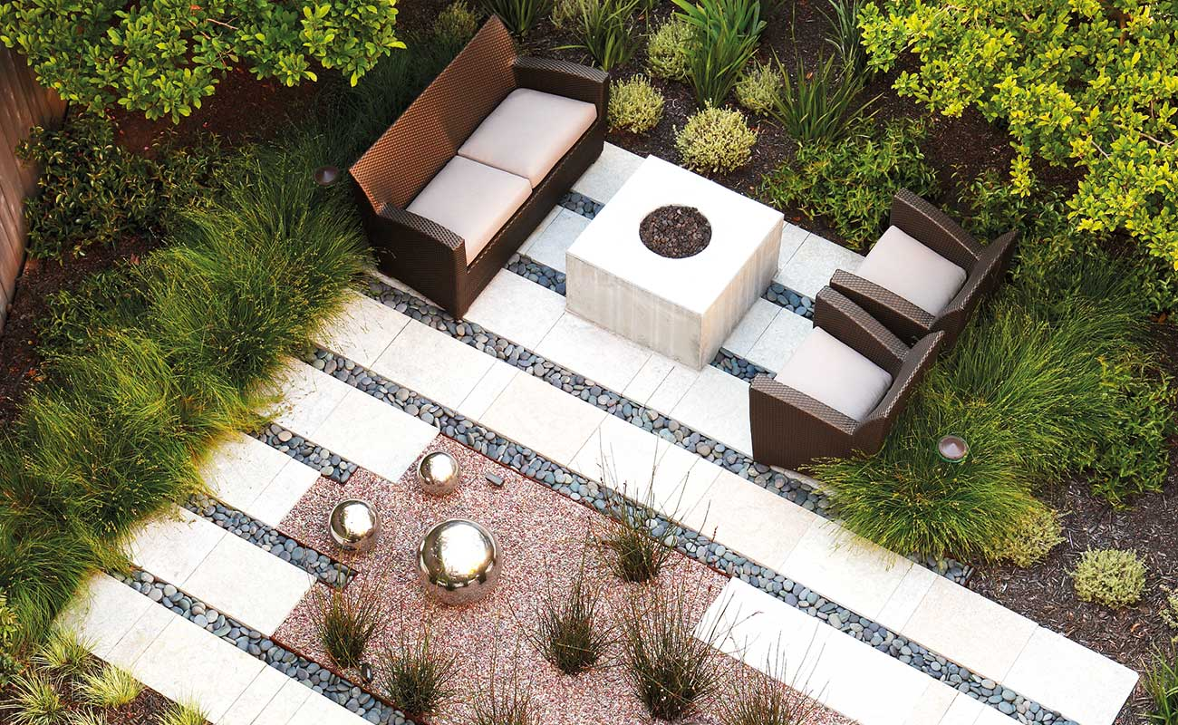 An outdoor garden with plants, floor tiles and decorative rocks in San Francisco