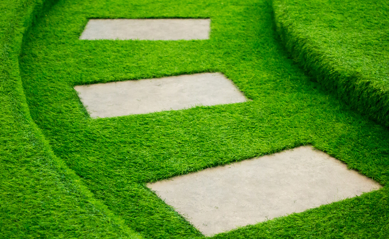 Lawn covered with synthetic grass offering a rich look