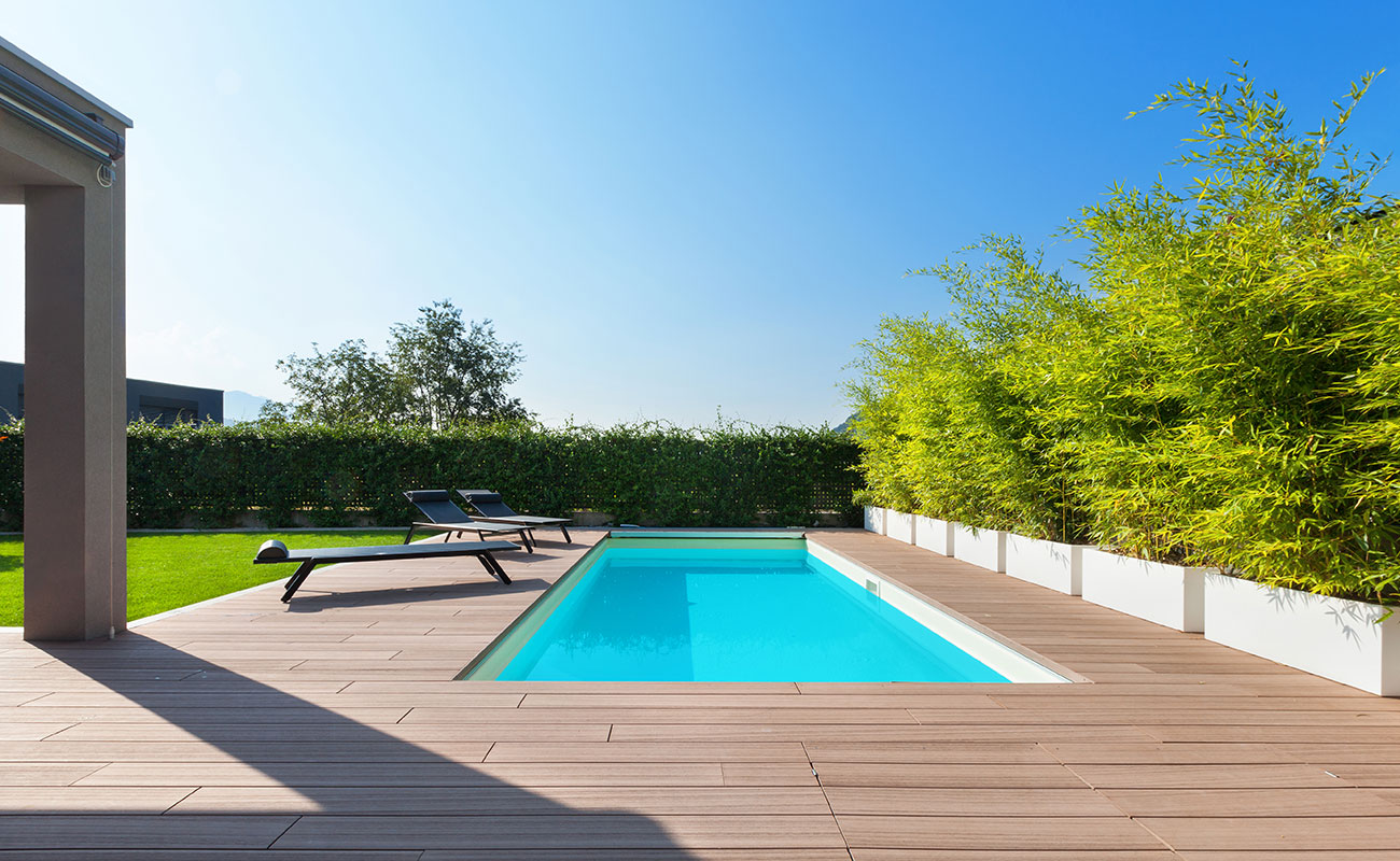 modern outdoor swimming pool with sun chairs
