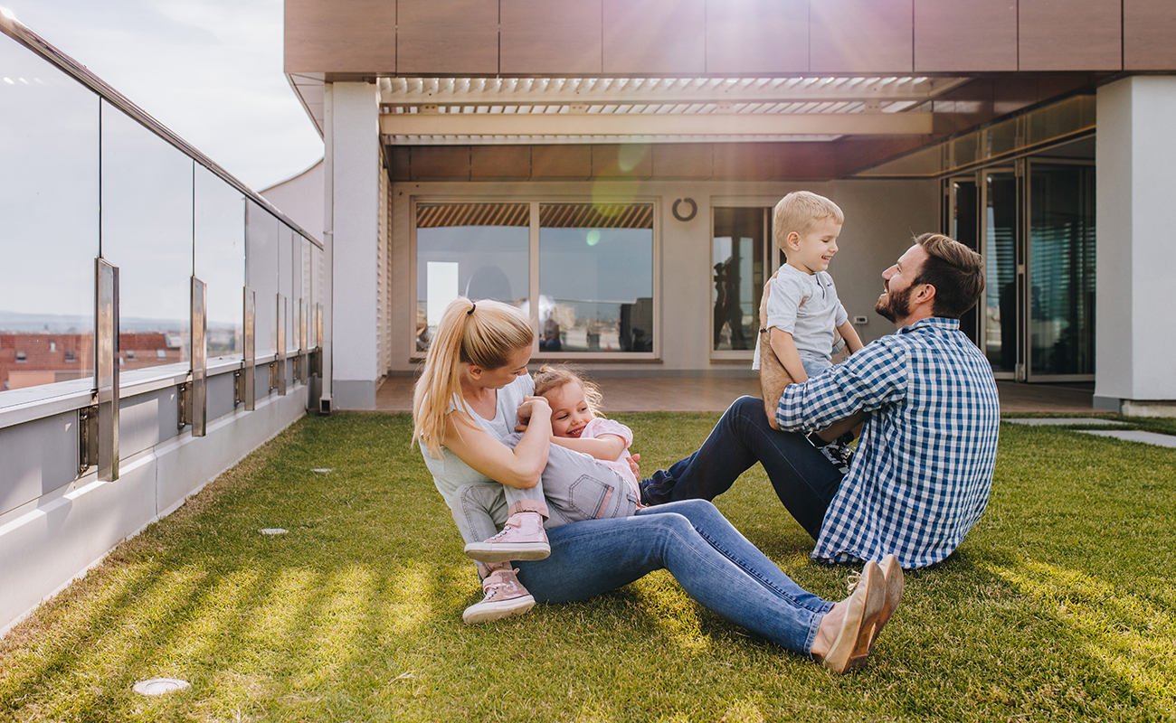 Family enjoying summer with kids  on turf lawns