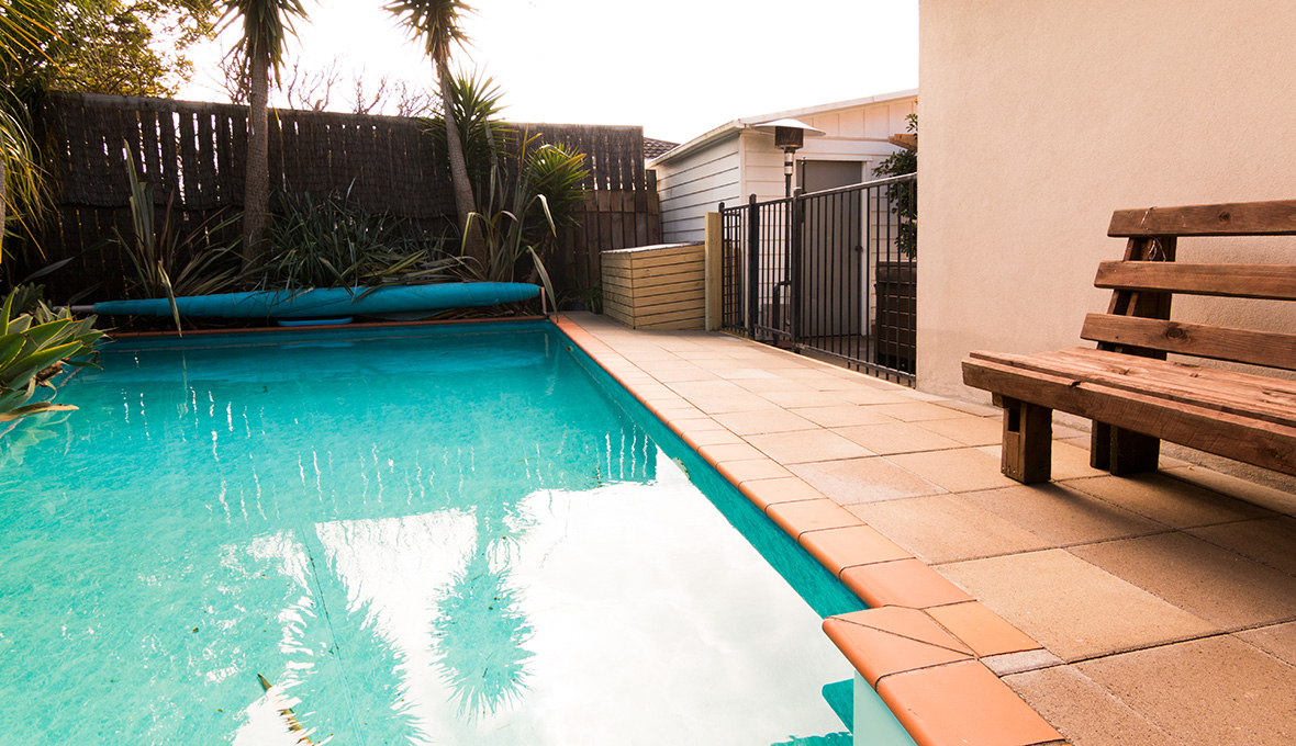 An outdoor makeover swimming pool with clean water