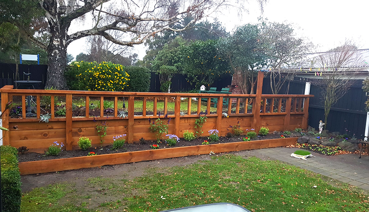 A new wooden retaining wall with plants