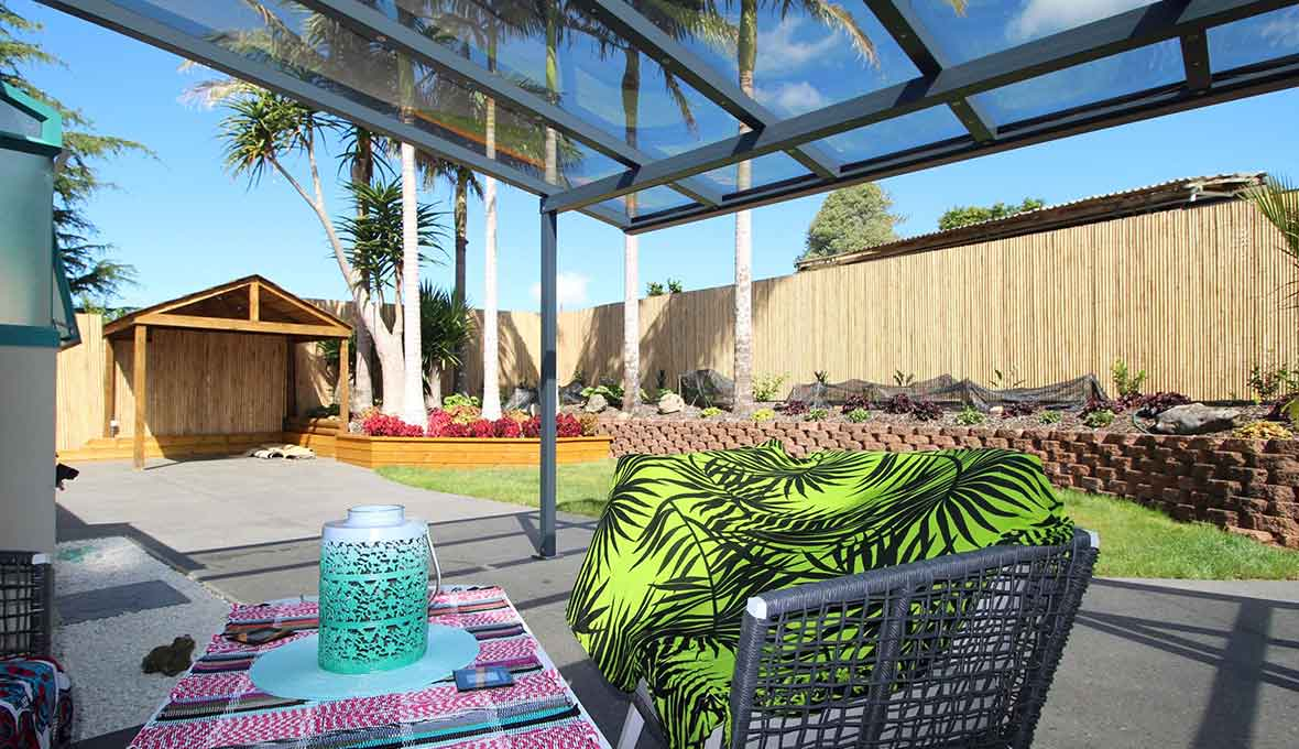 Creating a breathtaking subtropical oasis in Maunu with a concrete patio, lawn, and raised garden!