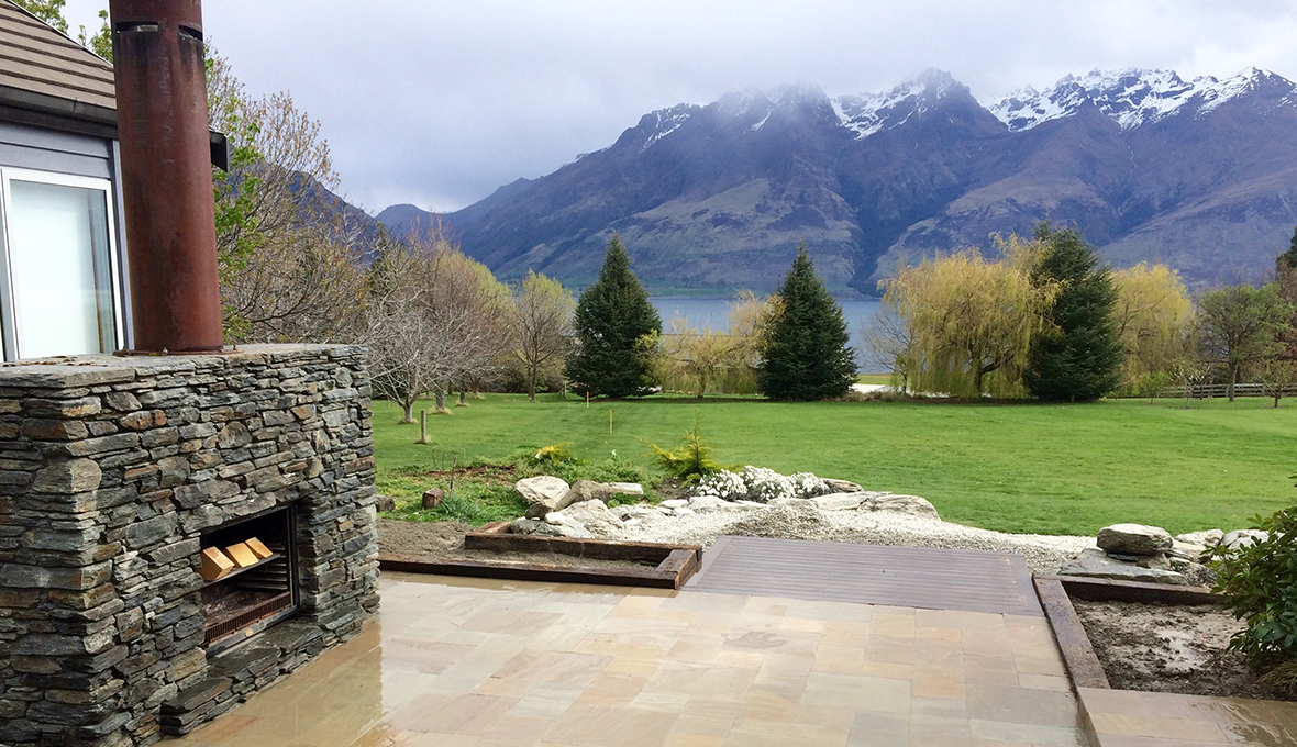 Outdoor room on lakeside estate overlooking the lake