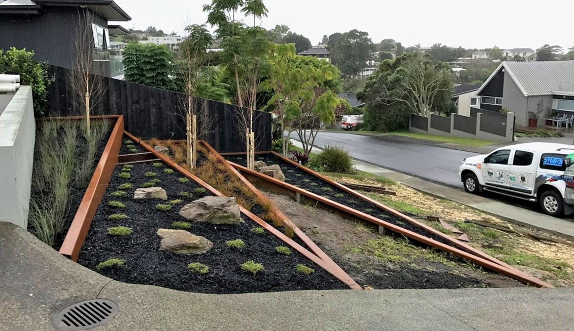Transformed steep driveway into a cool angular garden | Zones