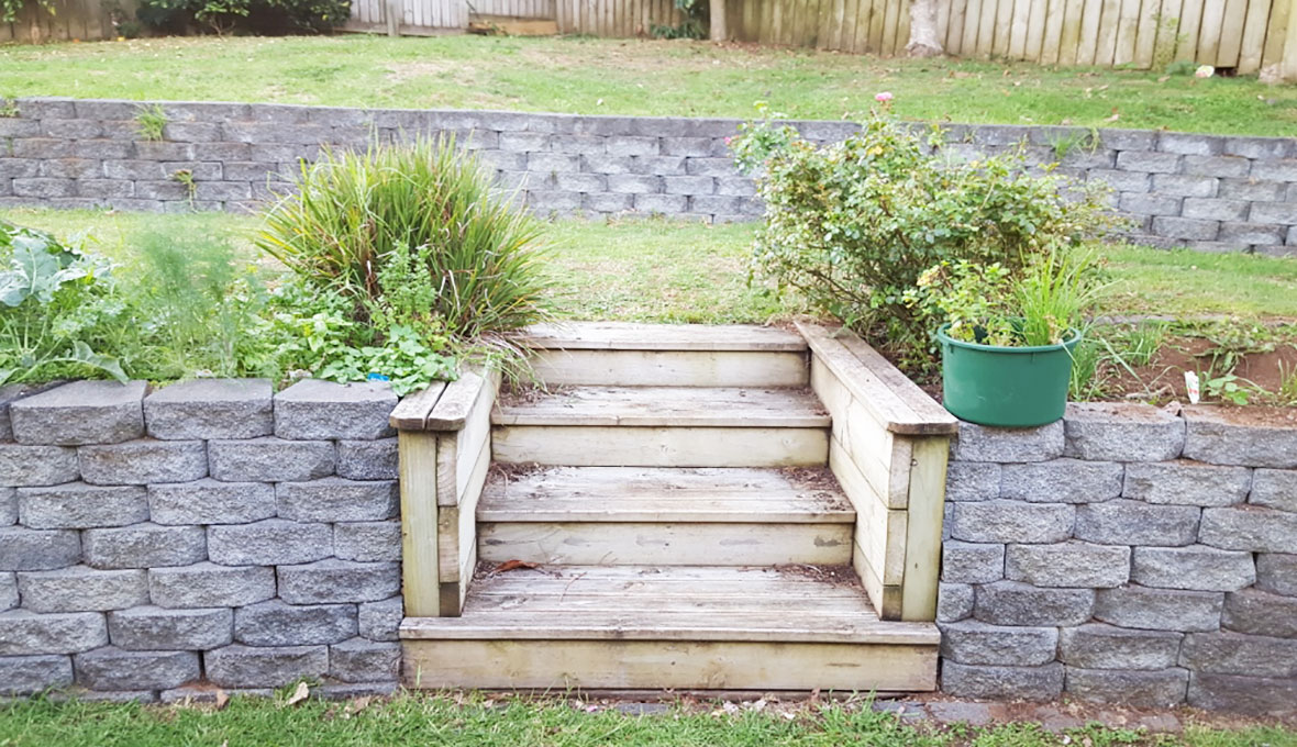 Before image of worn down steps leading to second level