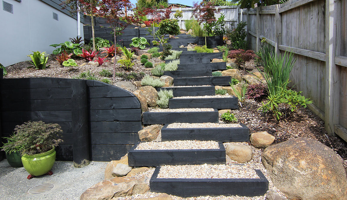 Steps leading to the several platforms of a suburban zen garden designed by Zones landscaping