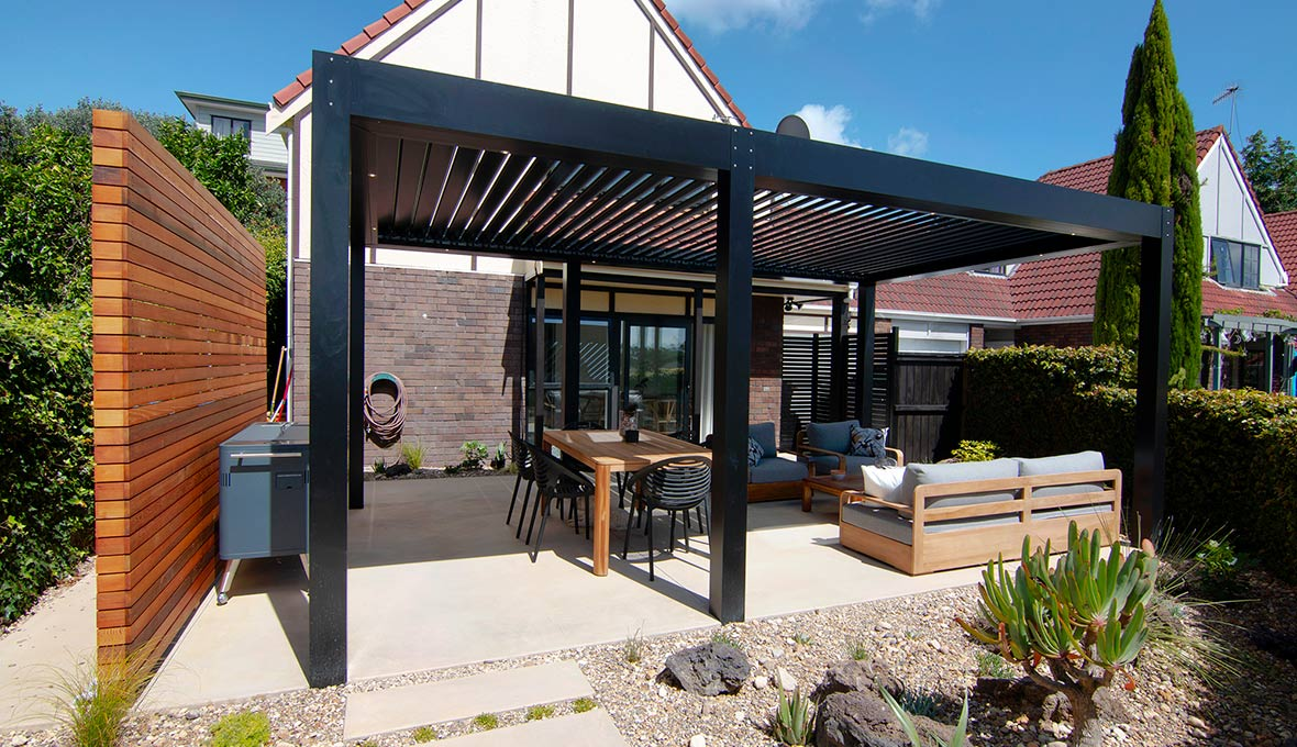 Renovation with aluminium powder-coated fence and gate, and a low maintenance garden.