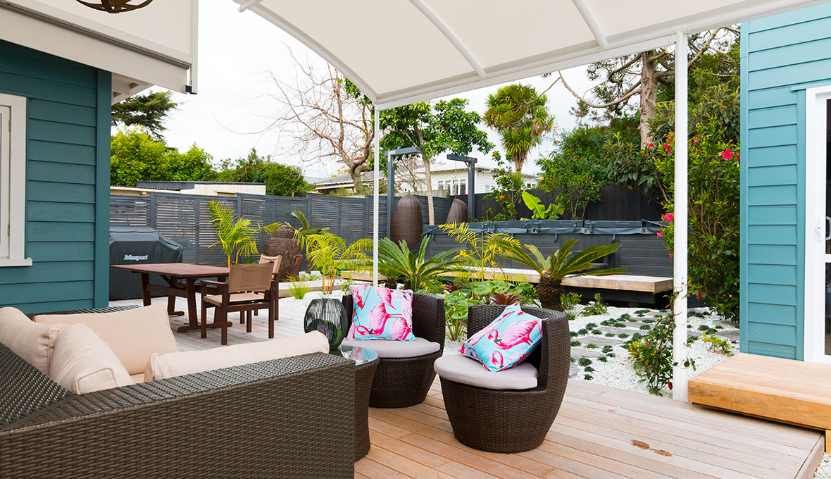 A backyard with new deck and outdoor furniture