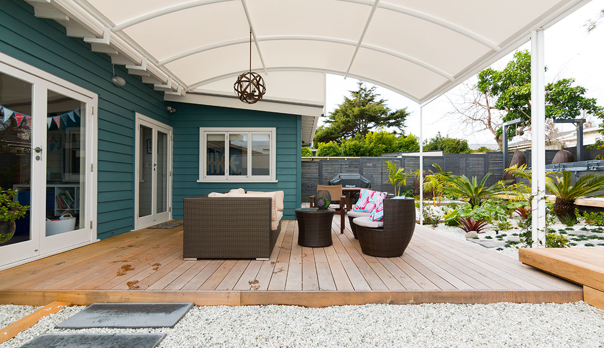 A backyard with new deck and pergola
