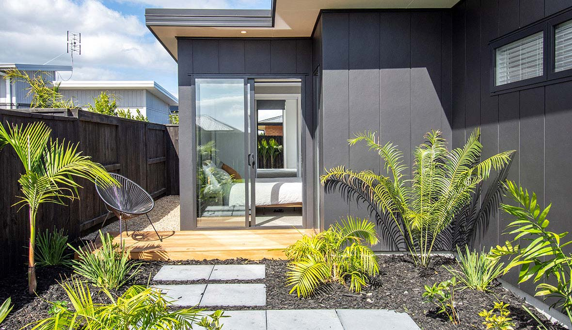 modern tropical garden with new pathway and deck to compliment