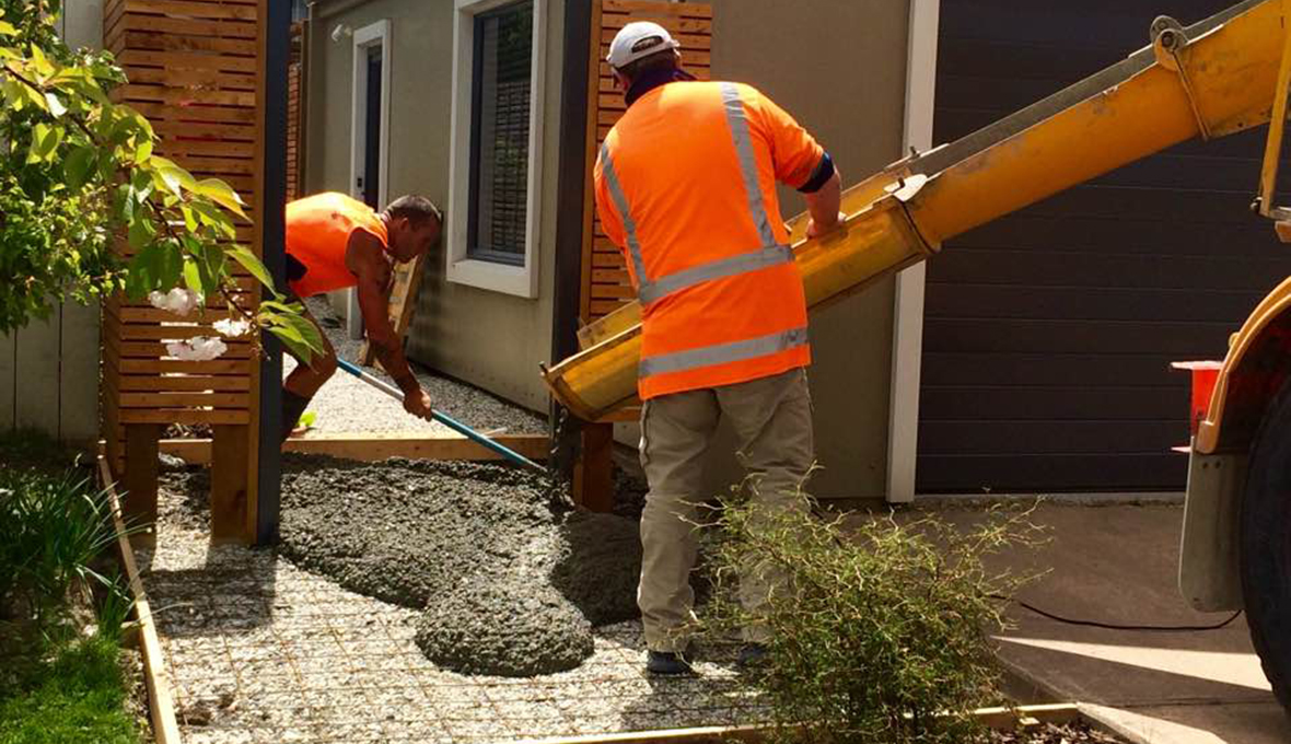 Zones team pouring a concrete path in Queenstown