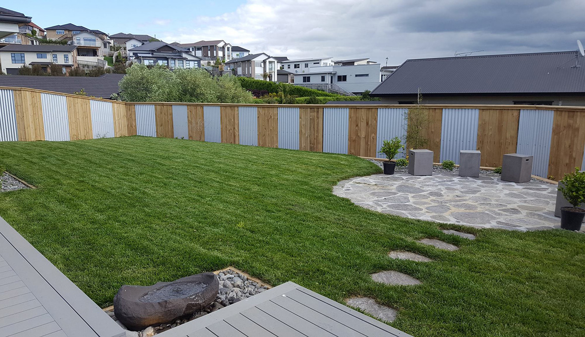 Yard with grass and stone steps in Pukekohe