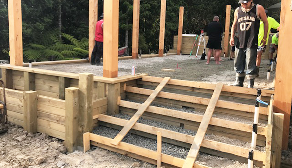 incomplete concrete stairs leading to the swim spa deck area