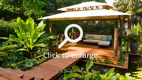 Zones landscaping Asian inspired pergola with surrounding water and foliage