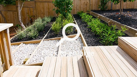 A wooden steps and plant boxes