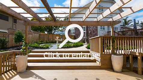 Outdoor space with pergola and garden view