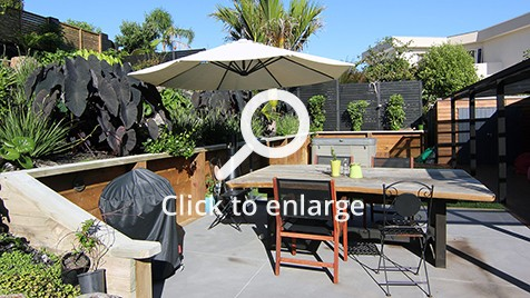 Outdoor entertainment area with outdoor dining table.