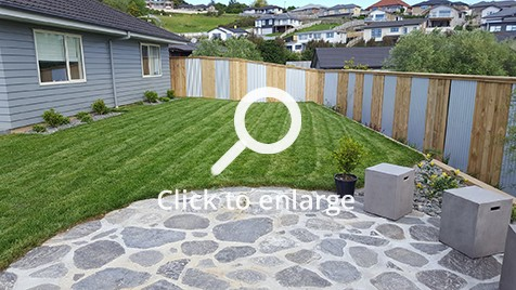 Fencing and grass in a backyard in Pukekohe