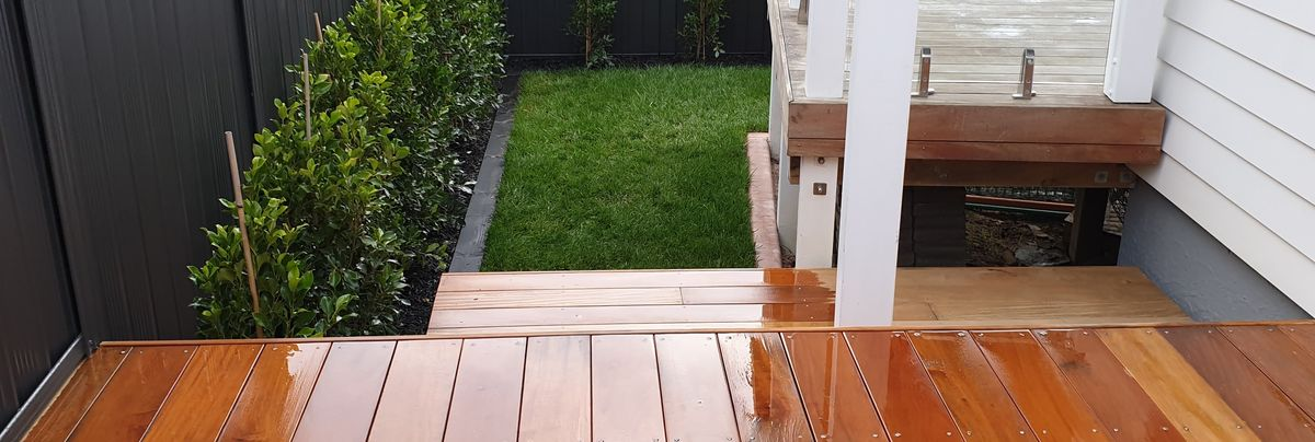 Deck and landscaped lawn