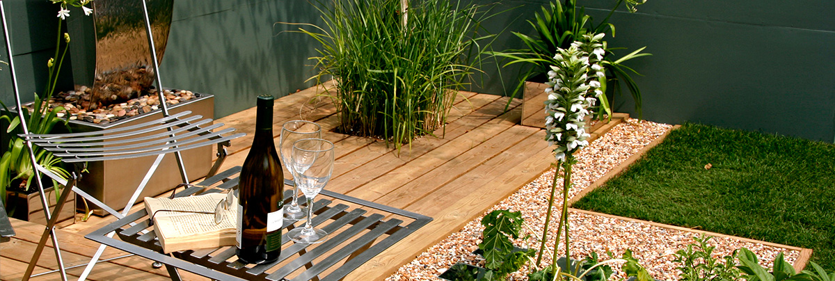 Basic garden design with basic timber decking and planting.