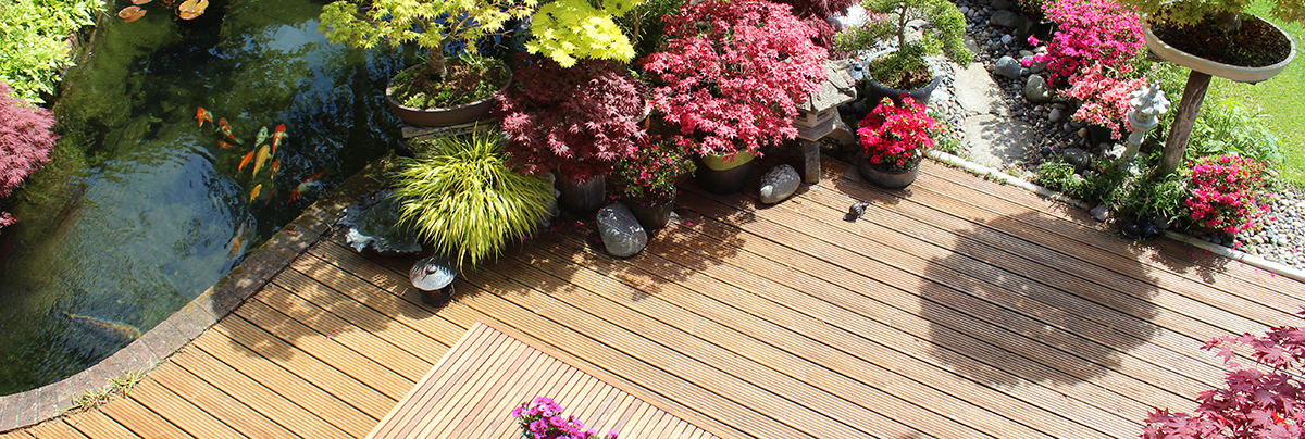 Backyard garden with wooden table and wooden deck