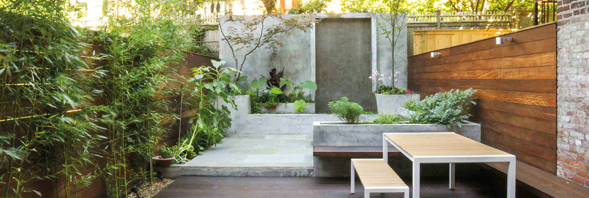Outdoor living area with concrete details and a wooden bench
