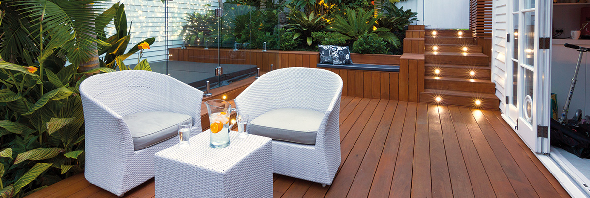 An outdoor relaxing place with white table and chair