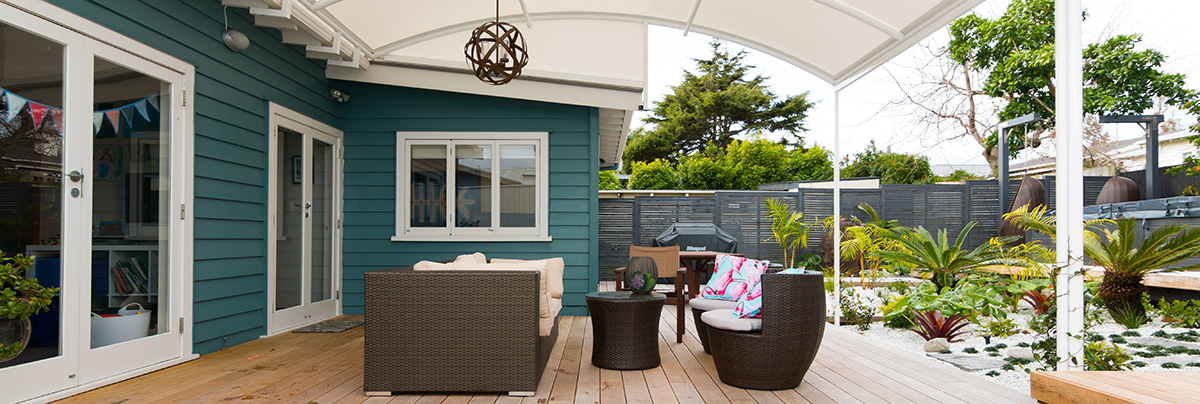 Outdoor living area with chairs on a deck in Auckland