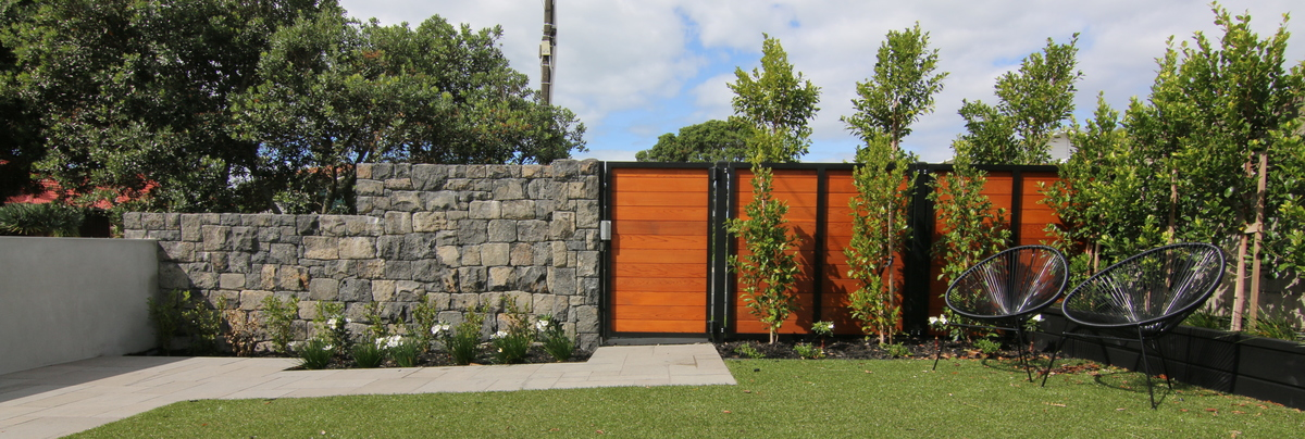 Landscaped garden with stone fence